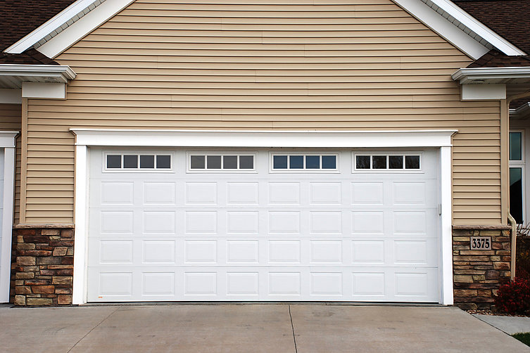 Thermacore garage door overhead door of cedar rapids for 16x7 garage door with windows