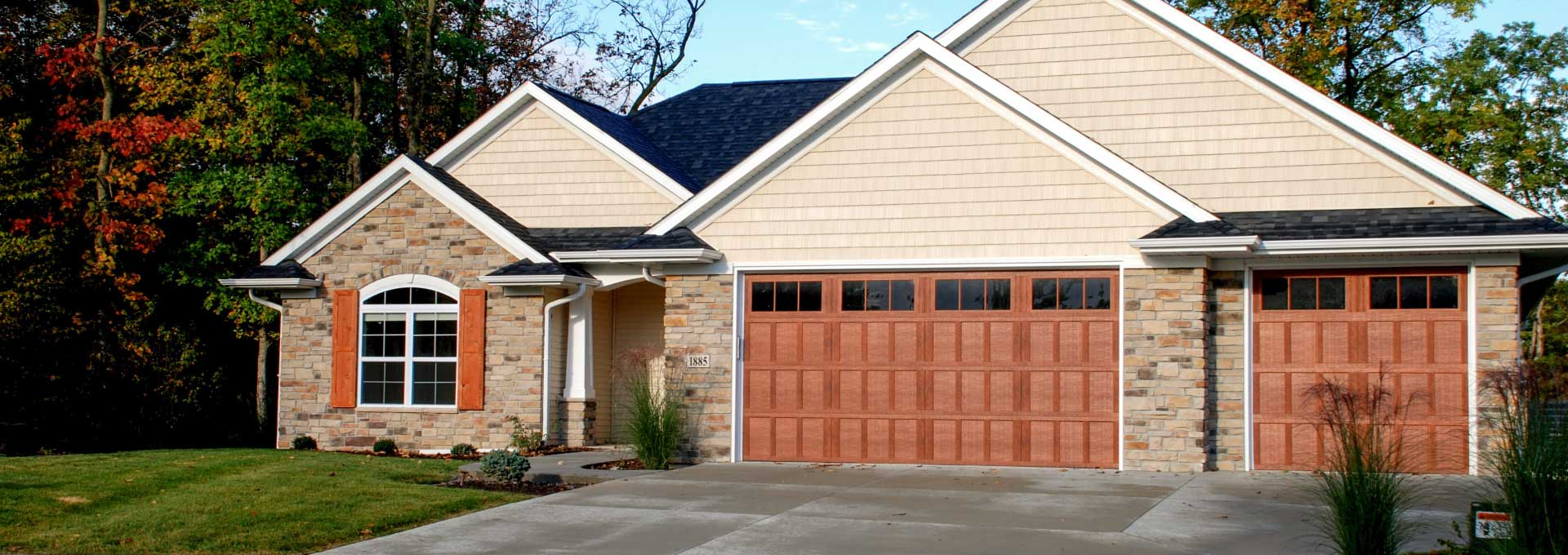 Distinctive maintenance free Carriage House designs available in stained and painted finishes.