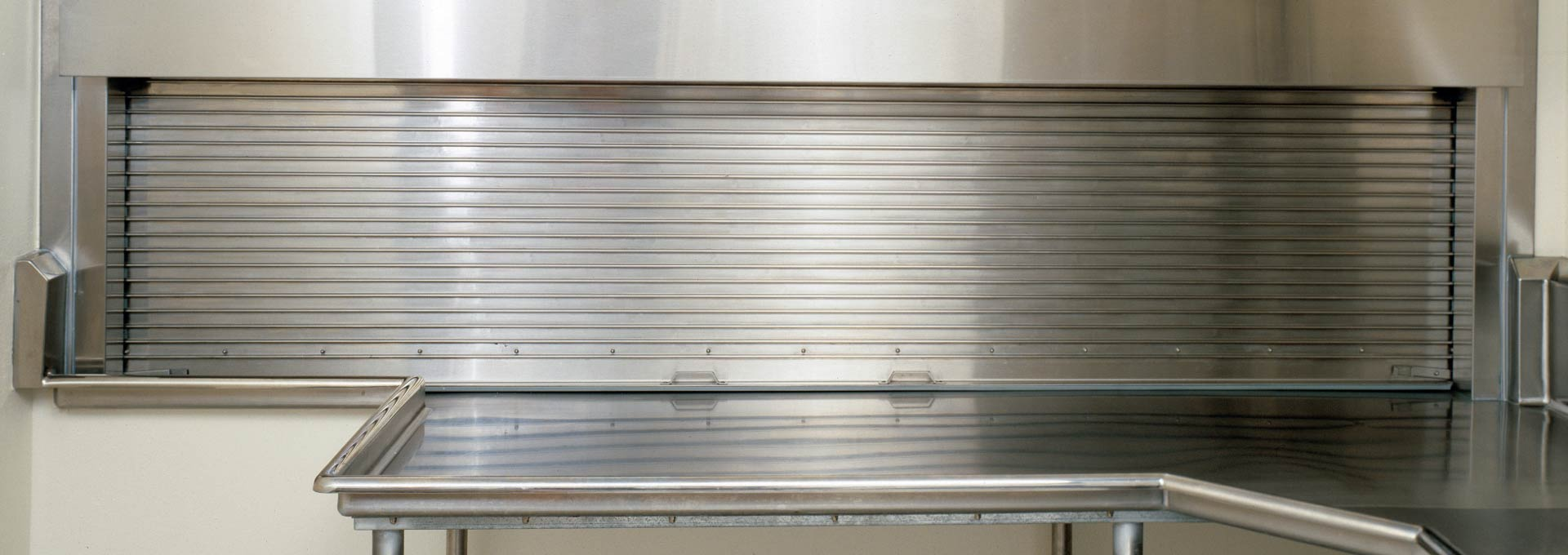 Comprehensive system of counter doors encompasses three basic types -- metal curtain, wood curtain and integral frame and sill