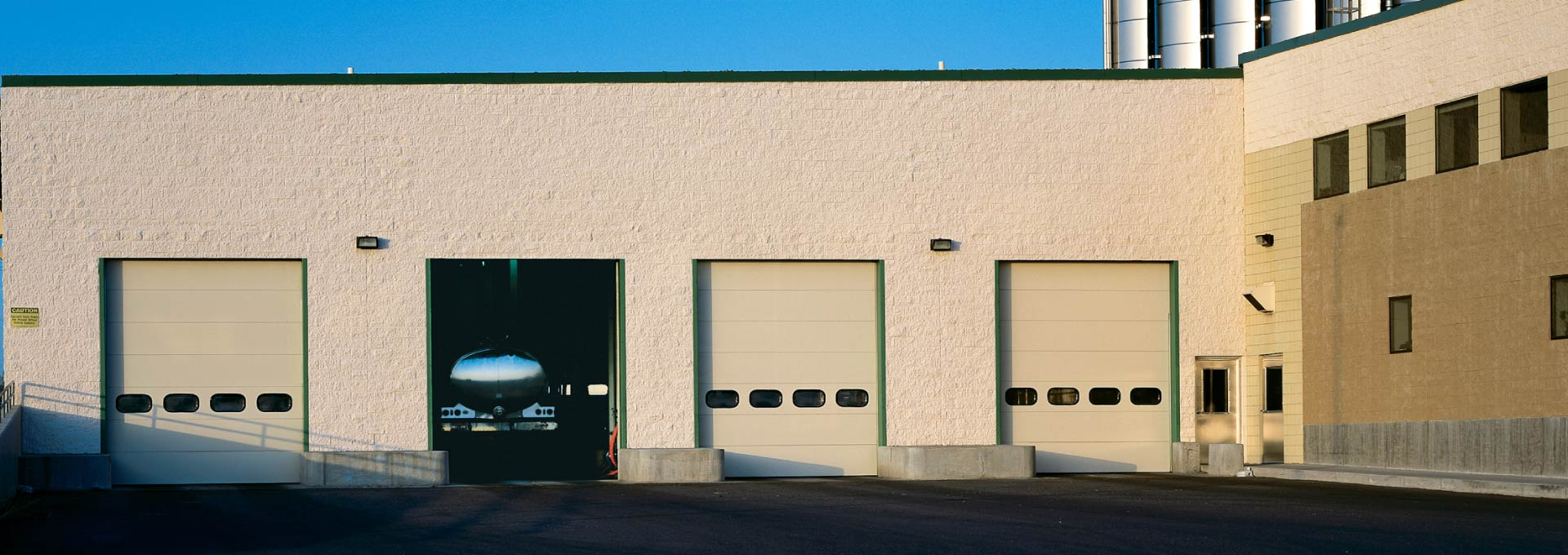 The industry's most comprehensive line of Insulated Sectional Steel Doors