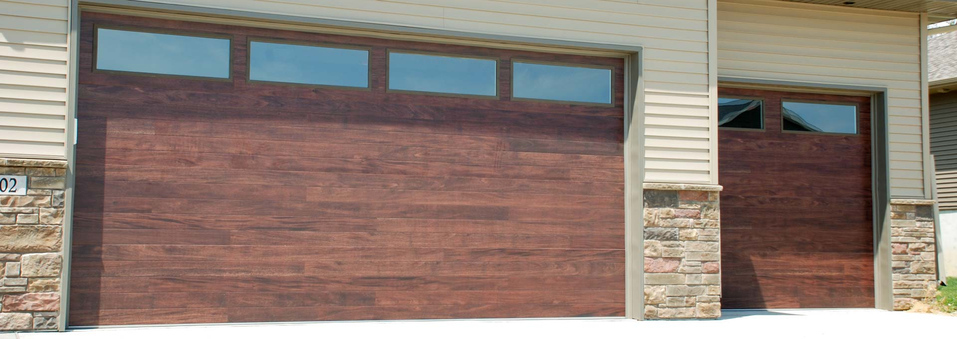 The unique look of stained wood on a maintenance free metal door.